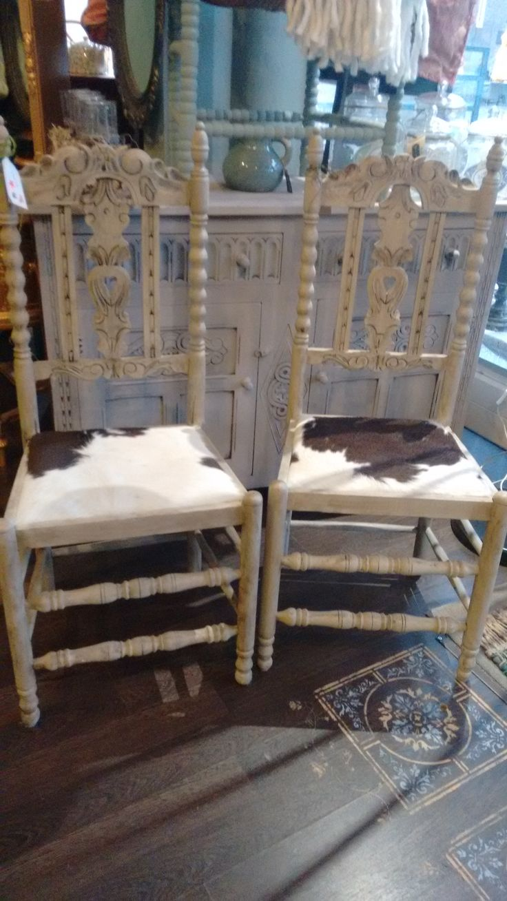 2 x country chairs. Painted in Country Gray and dark waxed. Reupholstered with cow skin. Available for sale @ Dress it up