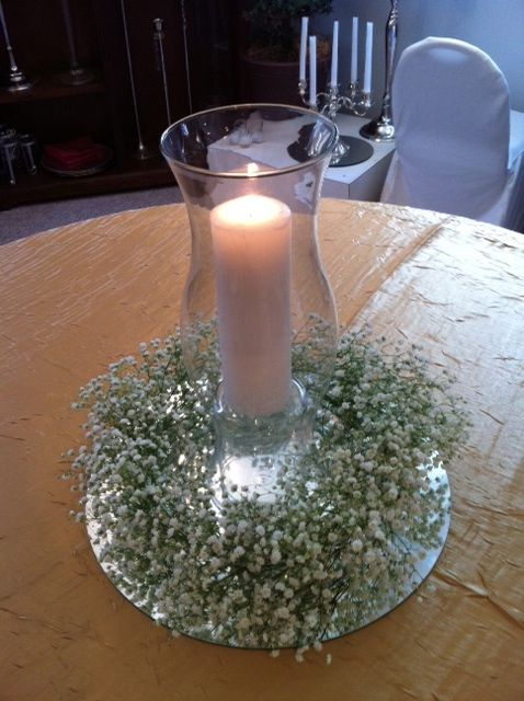 Simple, rustic baby breath wreath around hurricane lamp & pillar candle by All Grand Events