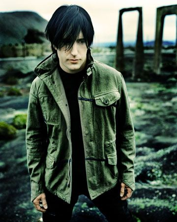 Trent Reznor - Any guy with dyed-black hair brings him up a few notches on my eye-candy meter.