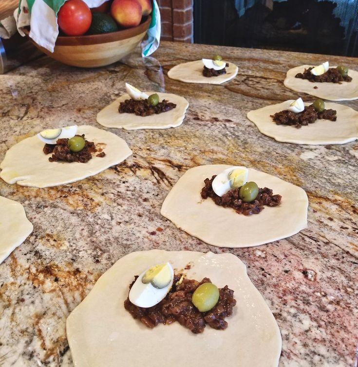 Empanadas De Pino, the iconic food of Chile. Recipe: https://adansblog.com/empanadas-de-pino-chilean-tradition-dish/