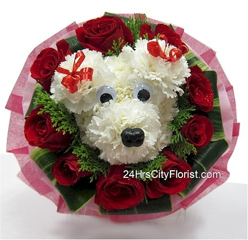 puppy bouquet at  http://www.24hrscityflorist.com/puppy-love.htm