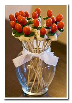 Edible Italian Centerpiece ~T~made with Buffalo Mozzarella, Cherry Pear Tomatoes and Basil Leaves on wooden skewers. How clever and looks so festive. Make a bunch and just keep refilling vases.
