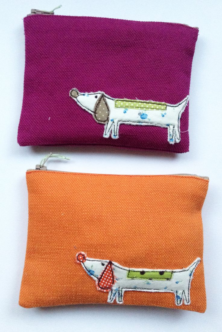 These are applique dog purses; I've decided I wouldn't use it as a purse but it would make a great pillow