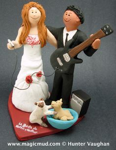 Bass Players Wedding Cake Topper This bride let the funky sounds of this bass guitarist woo her into a romantic mood, though she does hold the power to pull the plug if he insists on practicing on his wedding day! ,,,,if only the siamese cat will stop teasing the chihuahua about the honeymoon destination!......whatever the occasion, if a wedding, birthday, anniversary or any special event call 1 800 231 9814.... $240 #wedding#cake topper#guitar#bass#custom#bride#groom#rock and roll#musician