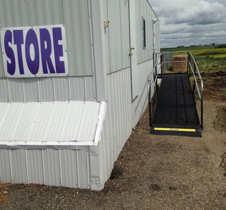 The owner of the Sunshine Hills Alpaca Ranch and the Twisted Sisters Alpaca Mill store in Rollyview, Alberta contacted Lorne Wensel, Amramp Alberta, to build a wheelchair ramp to provide better access to the store for bus tours visiting the ranch and accessing the store. Many of these visitors had difficulty going up and down the old stairs to the store.