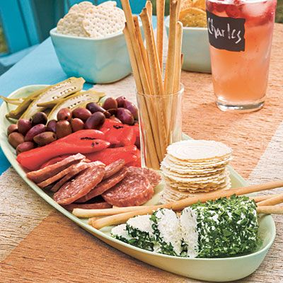 Wedding Bridal Shower Ideas: Simple Antipasto Platter-- roll a loag of goat cheese in fresh chopped parsley, sliced salami, pickled okra, kalamata olives, roasted red bell peppers, serve with assorted crackers and breadsticks. Prepare in advance and pop out of fridge!