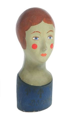 """This early-20th-century French papier-mache milliner's head has original paint with some crazing. Her name, """"Dorothee,"""" is written on the front. It sold in March at Garth's Auctioneers in Delaware, Ohio, for $646. Photo: Contributed Photo / The News-Times Contributed"""