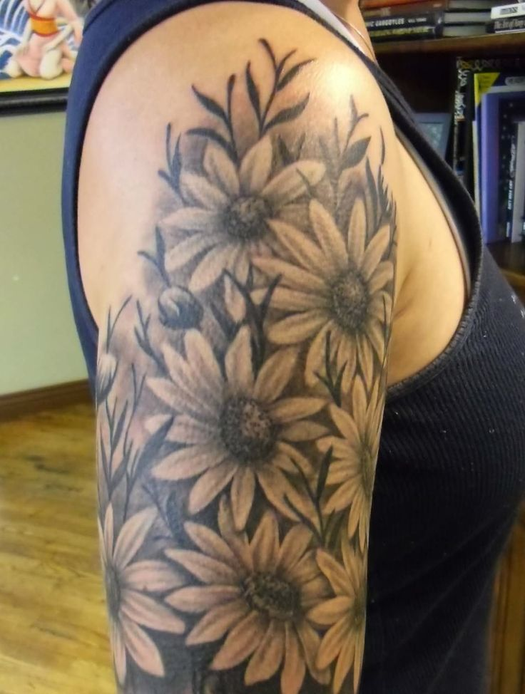 Black And Grey Daisy Flowers Tattoo On Right Shoulder