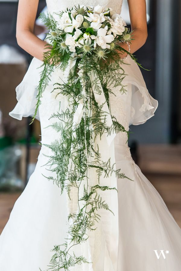 gardenia bridal bouquet. gorgeous gardenia feature stems: white gardenias, sea holly, cascade of plumosa fern and pearls