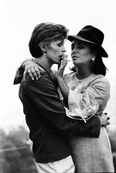 This one is my favorite, @Lisa Phillips-Barton Trent.   Elizabeth Taylor and David Bowie at their first meeting in Beverly Hills, 1975. Photograph by Terry O'Neill.