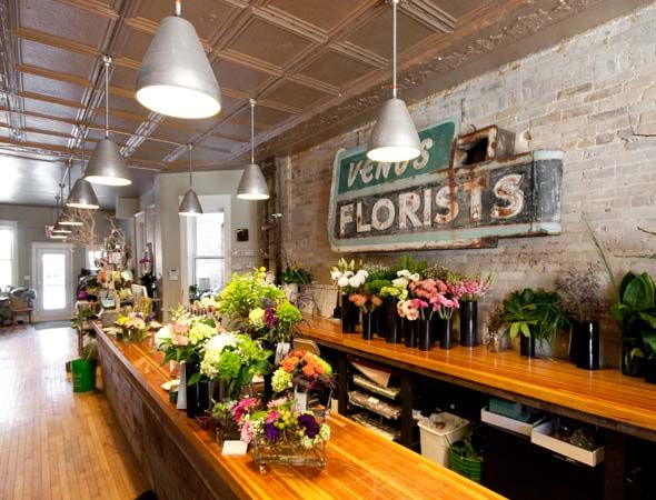I know it sounds crazy but I want a reclaimed brick wall like this and old wood, highly lacquered counters for work tables in the garage plus the two midcentury tables from Uncle Eugene's garage.... plenty of space for work and play....    @ Love the Blooms