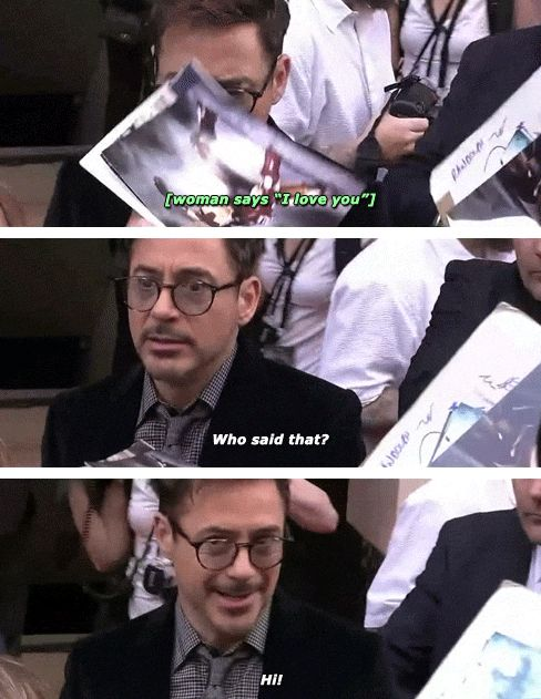 """Robert Downey Jr., signing autographs in Paris during the """"Iron Man 3"""" world press tour, greets a fan."""