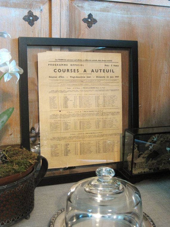 Living Room - Vintage French horse racing schedule in double-sided glass frame