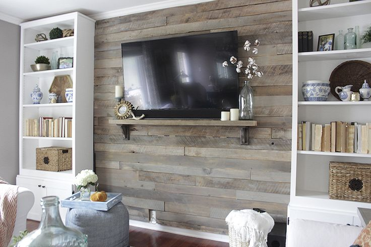 How to build a pallet accent wall with TV mounted on top. Link to tutorial show show to hide all wires plus safety tips on using the correct type of pallet.