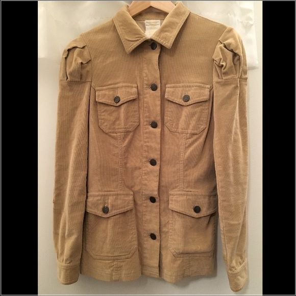 Authentic ANNA SUI Beige Corduroy Blazer Jacket Authentic!!!!! Bought in Anna Sui Soho NYC. Worn couple times in excellent condition. No stain, no any defect and odor free. Size 2. This blazer jacket is slim cut with stretch corduroy fabric. Little puff sleeves. Anna Sui logo details on buttons. Please be sure you size or else I will happy to provide you detail measurement. Anna Sui Jackets & Coats Blazers