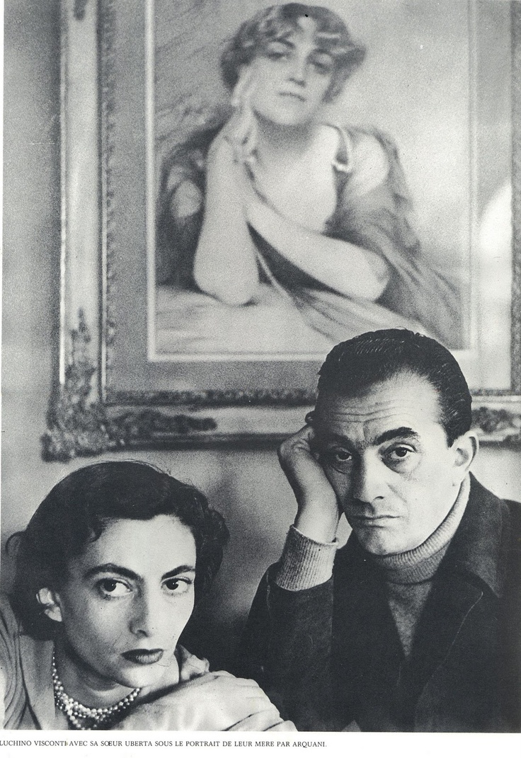 Luchino Visconti with his sister Uberta under a portrait of their mother.