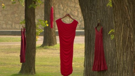 Several red dresses are hanging in spot at the University of Saskatchewan this week to remind people of missing and murdered Aboriginal women. It's an art project by Winnipeg artist Jaime Black.