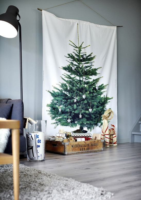 A pine tree printed fabric hanging is festive without the mess! #Alternativetree #Christmasdecor @weddingchicks