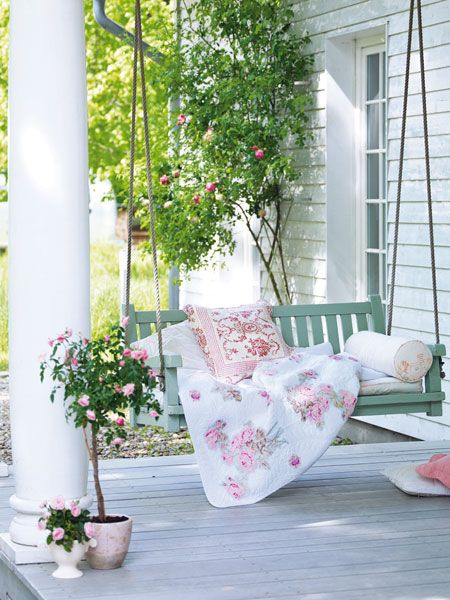 Both my grandma's had front porch settings - many great memories of just swinging & talking :) we didn't have cozy pillows or blankets though, love how this looks!