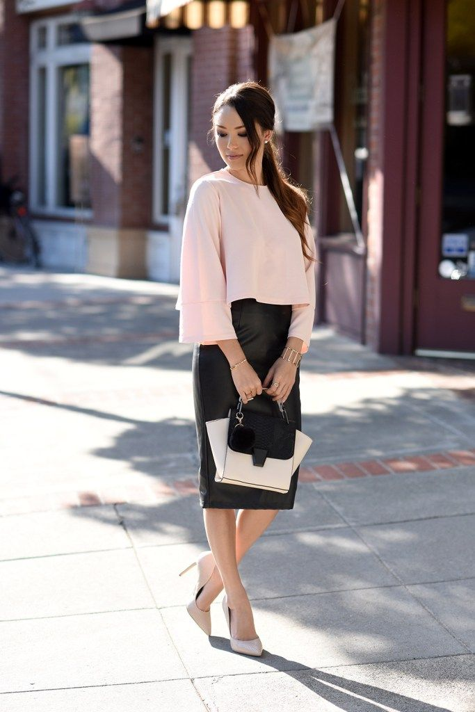 Jessica looks chic and lady-like in a feminine pink blouse and nude pumps. She adds some edge with her black leather skirt. If you want an alternative idea, pair your skirt with a white vest for a more form-fitting look.  Top: West L.A boutique, Skirt: Vintage, Pmps: Steve Madden, Bag: Melie Bianco, Cuff: Bebe, Earrings: Dainty and Bold