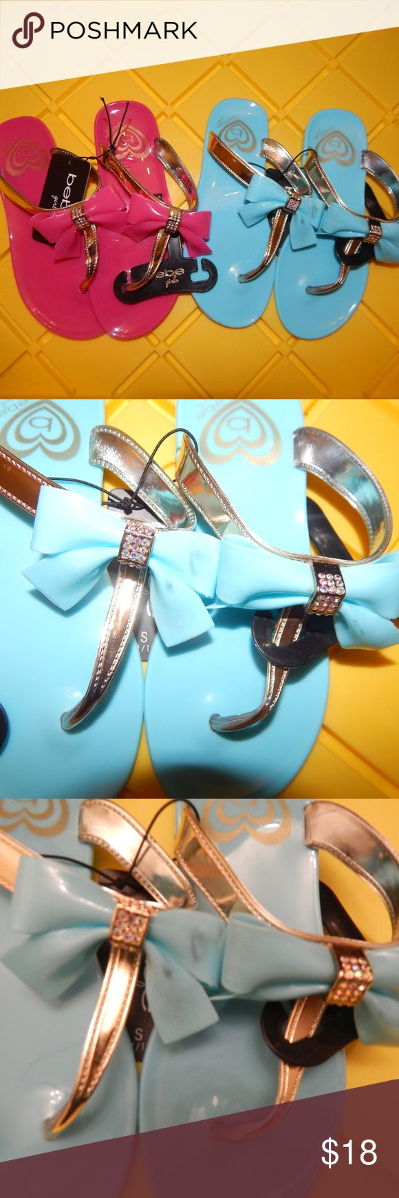 NWT Bebe Girl's Rhinestone & Bow Flip Flop Bundle Great summer time shoe for little girls Size: S 11/12. 2 PAIR for the price of one. Plastic but sturdy. Thong slip on flip flop with a bow with rhinestones. Perfect for those warm day's. No Trades just great bargain's. Firm price, fast shipping and a free gift with every order. Bebe Girls Shoes Sandals & Flip Flops