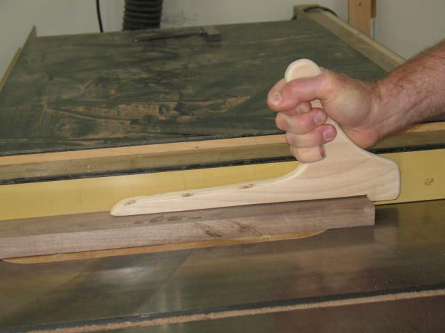 Steve Shanesy shows off his push stick for table saw use. The design is ergonomic, and improves safety.