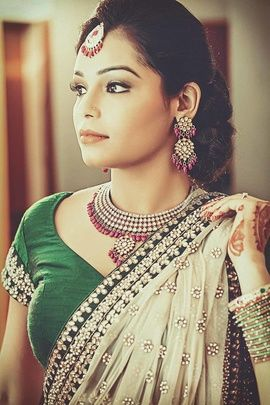 Indian Wedding Jewelry - Traditional Polki and Ruby Bridal Necklace and Earrings with Maangtikka to go with Cream and Green Lehenga | WedMeGood #wedmegood #polki #ruby #jewelry