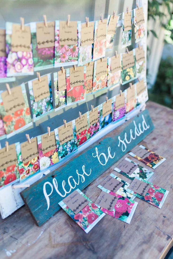 Floral Escort Cards!  Very adorable idea! Creative way to show people to their seats