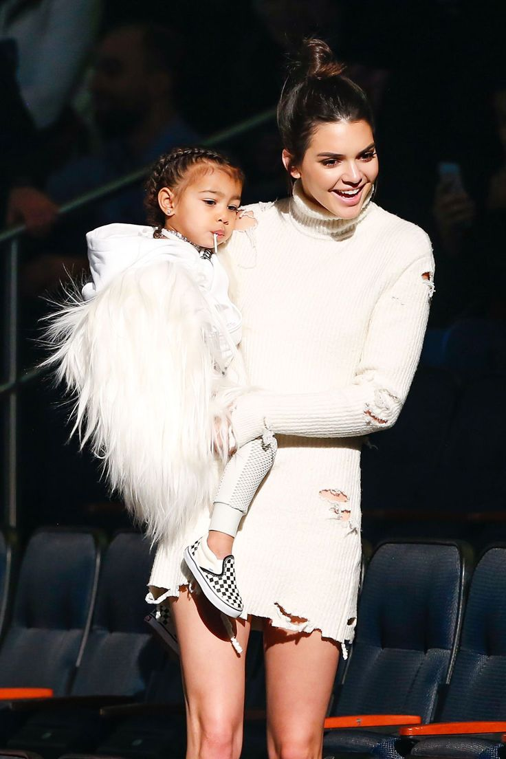 The two-year-old's sass levels are through the roof, so being carried to her seat at the most talked-about fashion show of all TIME was just another normal day for North... Like, whatevs