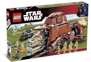 """Lego Star Wars 7662 - Trade Federation MTT with 16 Regular Battle Droids, 2 Red Security Battle Droids, 2 Blue Pilot Battle Droids and a Destroyer Droid (1326 Pieces) by LEGO. $619.99. Includes 16 regular battle droids, 2 red security battle droids, 2 blue pilot battle droids and a de. Open the sides to see inside!. Turn gear on side to extend the storage rack and deploy the battle droids!. Trade Federation MTT measures 16"""" (41 cm) long and 10"""" (25 cm) high!. Trade ..."""