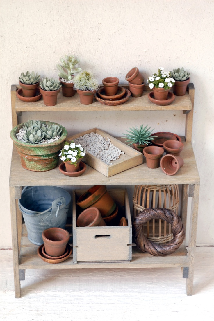 A really nice miniature potting bench done with succulents,