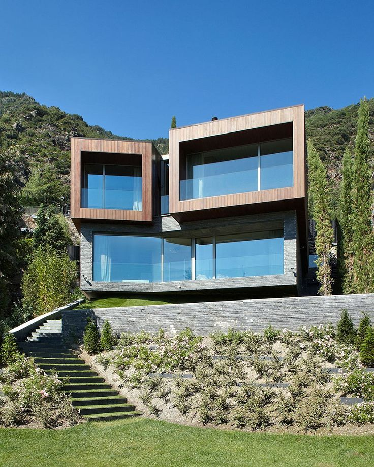 Large glass windows and doors open the