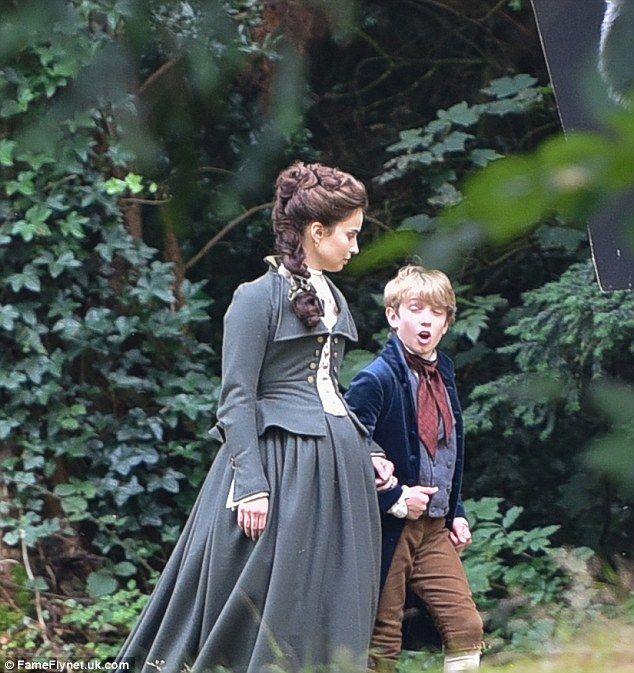 Eye-catching: Heida's Elizabeth Poldark wandered through a forest with a young boy for one scene