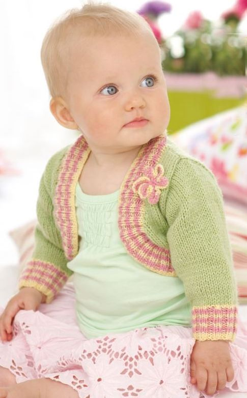 Free Knitting Pattern for Snuggly Baby and Child Bolero - Free for a limited time only. Ribbed border with optional color stripes, attached knitted flower.SizesBirth – 7 years (chest 16-26″/41-66cm). Designed by Sirdar.