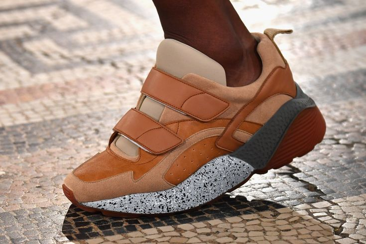 Stella McCartney's Platform Trainers Will Be Everywhere This Fall: Just as the fashion crowd begins to retire their Stella McCartney brogues, the brand sent an equally stylish replacement down its Fall'17 runway: platform trainers. Colorful, retro (kind of like Kanye's new Yeezys), and versatile enough for everyday wear, these sneakers will likely be a celebrity favorite in practically no time. | coveteur.com