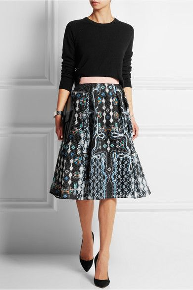 Equipment (sweater). Peter Pilotto(skirt). Gianvito Rossi (pumps). Givenchy (clutch).