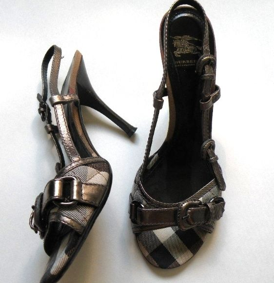 Beautiful authentic Burberry Shoes High Heel Slingbacks Made in Italy Dark Silver Leather that has a nice metallic sheen to it. Size: 39 (I take a 9 and they fit me) I purchased these new at the Burberry Outlet store about a year ago. If you have ever been to the outlet, you know they are also as pricey as the regular stores. I wore these a total of 3-5 times. Normal wear on bottom sole of the shoes. Tops are in excellent condition as is the inside. Smoke free home
