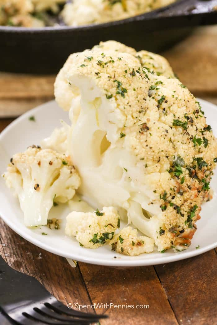 Whole roasted cauliflower is a deliciously-tender, healthy option that is nice and crispy on the outside but soft and moist on the inside.