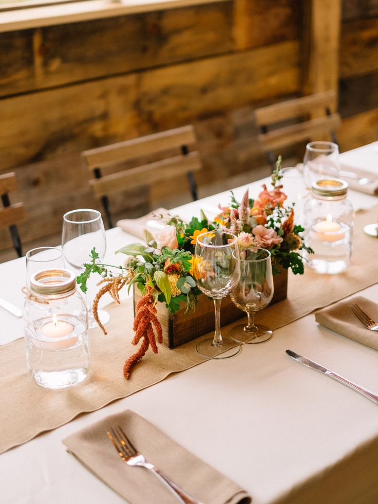 Photography by Micheal Beaulieu August 'rustic' centerpieces with peach and burnt-orange local flowers