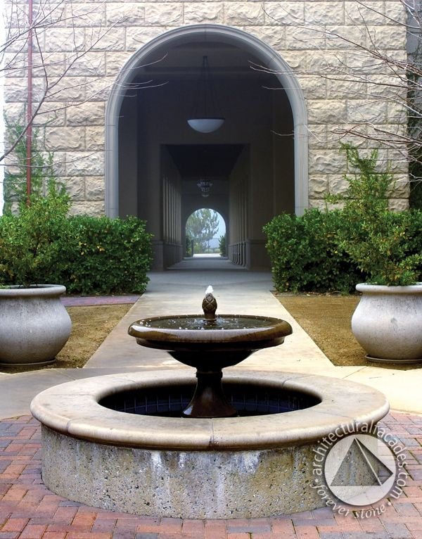 Rustic stone facade with a beautiful fountain.