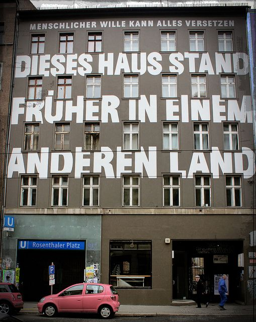 """Human will can achieve anything"" (Menschlicher Wille kann Alles Versetzen) - ""This house stood in another country before"" (Dieses Haus stand frührer in einem anderen Land) -- Berlin 2010"