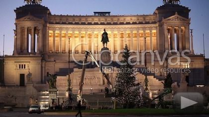 Stock video for sale at ClipCanvas: Video clip of the decoration of Christmas tree in Piazza Venezia, Rome, Italy.