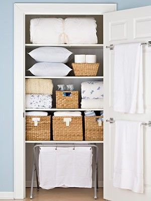 Organizing the closet across from the bathroom. Include a shelf with toilet paper, cleaning supples, etc...