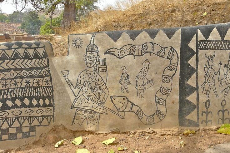 Tiébélé, Burkina Faso, Africa. The Kassena people are known for their Gourounsi mud architecture and walls elaborately decorated by the village women.