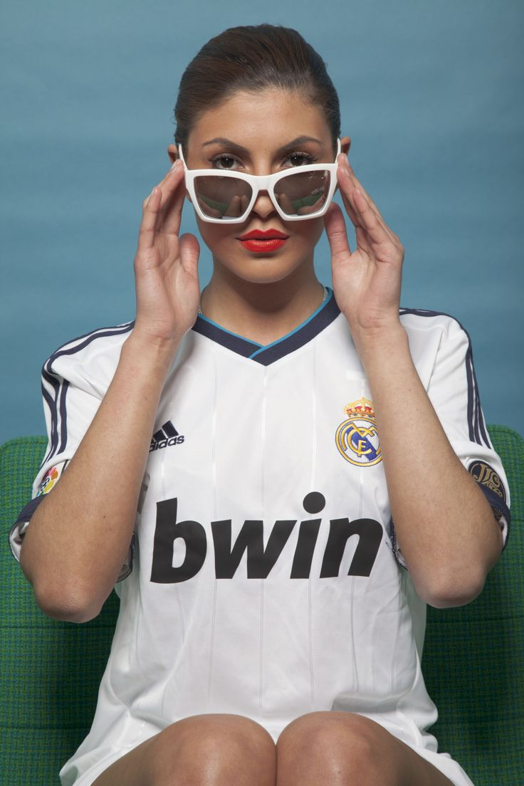 Real Madrid home jersey girl looking over the top of the glasses. White on white.