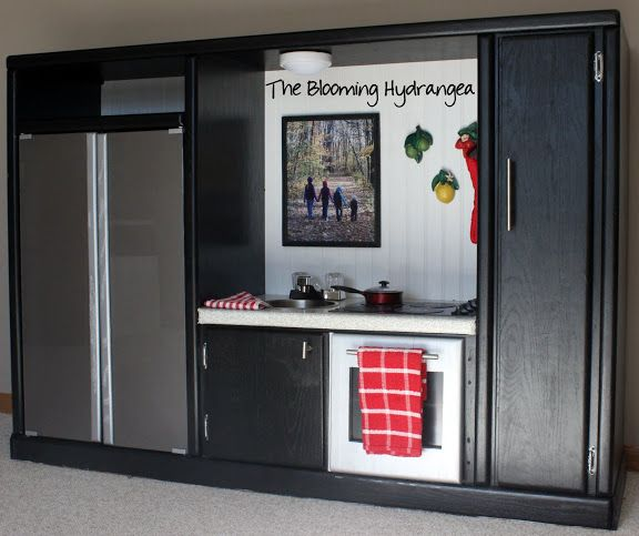 Diy entertainment center into a play kitchen beautiful for Play kitchen designs