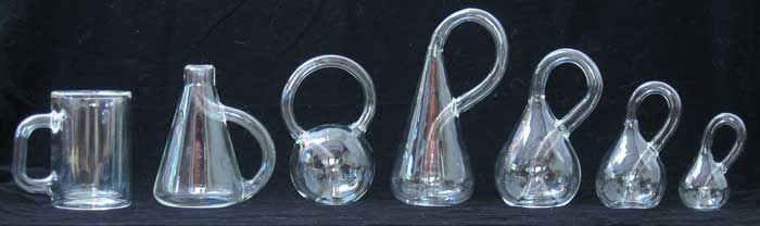 genuine glass Klein Bottles. These are the finest closed, non-orientable, boundary-free manifolds sold anywhere in our three spatial dimensions.    These elegant bottles make splendid gifts, outstanding classroom displays, and inferior mouse-traps. With its circle of singularities, an Acme Klein Bottle can be said to exist inside of itself -- especially handy during time-reversals.