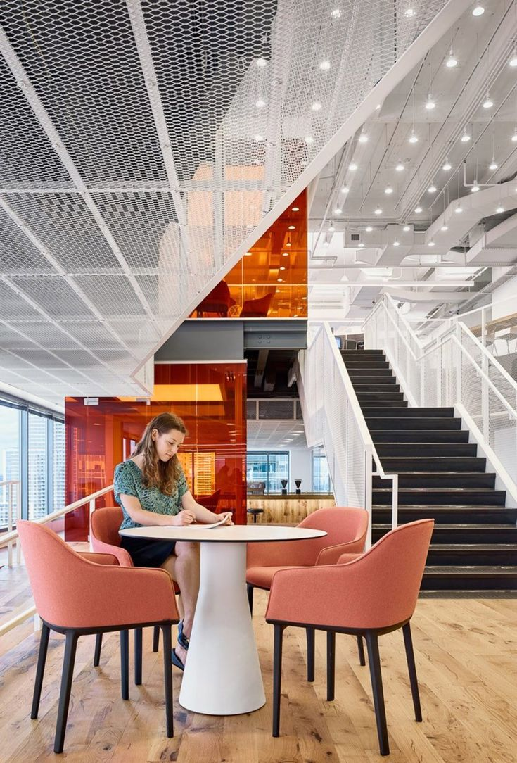 GLG Austin office by Clive Wilkinson. office for tech company GLG, which features an open-office plan and a variety of communal workspaces.