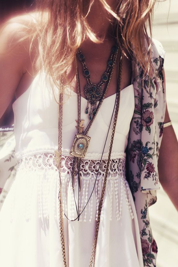 Feminine boho lace fringe dress with modern hippie fashion layered necklaces for a gypsy Bohemian look