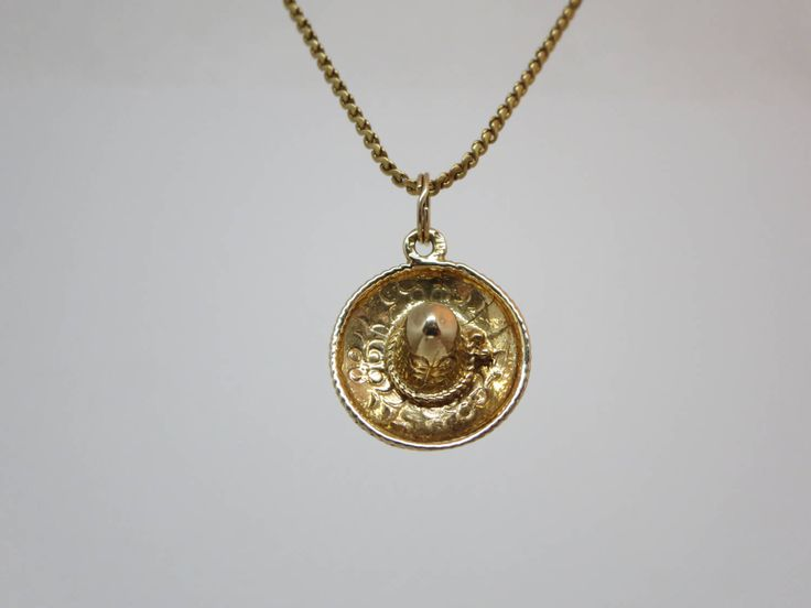 10K Gold Miniature Mexican Hat Pendant Pretty patterns all around Spiral ring for easy attachment to a charm bracelet Stamp: 10k  In good condition Tested and guaranteed!  Diameter : 2 cm Weight: 2.33 g   **** DISCOUNT CODE! VISIT OUR HOME PAGE **** Https://www.etsy.com/ca/shop/LesCurieux?ref=hdr_shop_menu